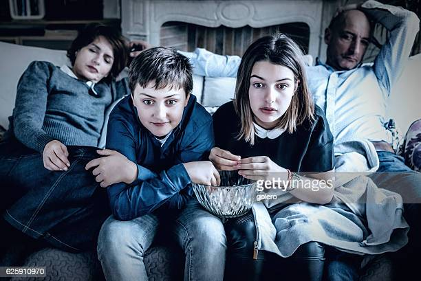 Kids watching tv with parents