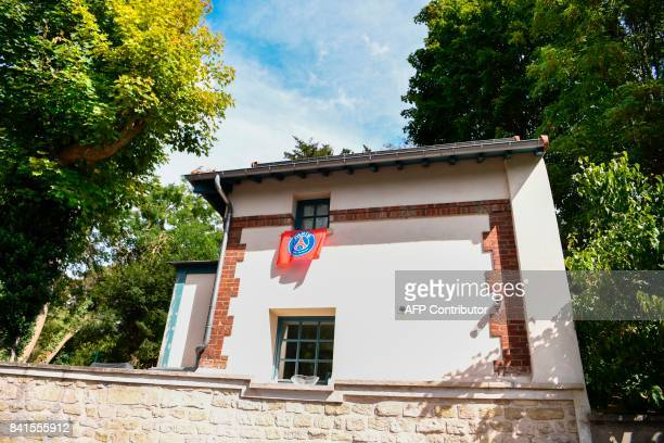 A French L1 Paris SaintGermain fan flag is pictured at the window of a house neighbouring the one of Brazilian superster Neymar in Bougival a western...