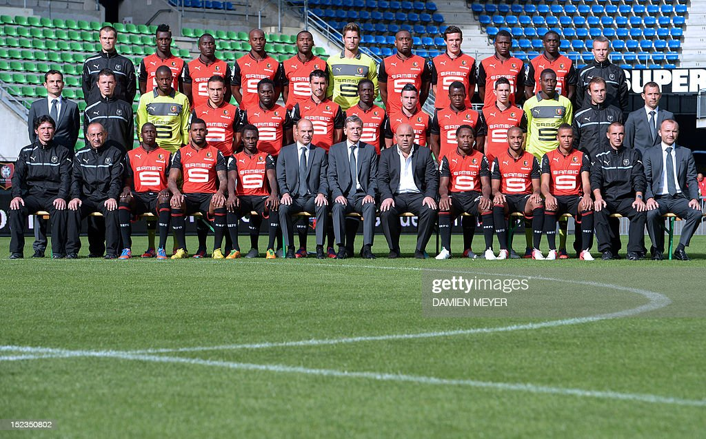 French L1 Stade Rennais FC football players and staff members pose for the 2012 official group picture, on September 19, 2012 at the route de Lorient stadium in Rennes, western France. From L to R, 1st row: assistant coach Laurent Huard, assistant coach Jean-Marie de Zerbi, players Abdoulaye Doucoure, Yann M'vila, Jonathan Pitroipa, general manager Pierre Dreossi, president Frederic de Saint-Sernin, head coach Frederic Antonetti, players Jean Makoun, Yassine Jebbour, Axel Ngando, assistant coach Nicolas Dyon, and doctor Karl Chaory. From L to R, 2nd row: sporting director Jean Francois Creach-Cadec, assistant coach Kevin Plantet, players Abdoulaye Diallo, Mevlut Erding, Onyekachi Apam, Julien Feret, Victor-Hugo Montano, Romain Alessandrini, Cheik-Fantamady Diarra, Vincent Pajot, Cheik Ndiaye, assistant coach Christophe Revel, and sporting coordinator Elouan Vivier. From L to R, 3rd row : physiotherapist Jocelyn Courtois, players John Boye, Abdoulaye Sane, Dimitri Foulquier, Kevin Theophile-Catherine, Benoit Costil, Jean-Armel Kana-Biyik, Romain Danze, Sadio Diallo, Chris Mavinga and physiotherapist Yannick Logeais.