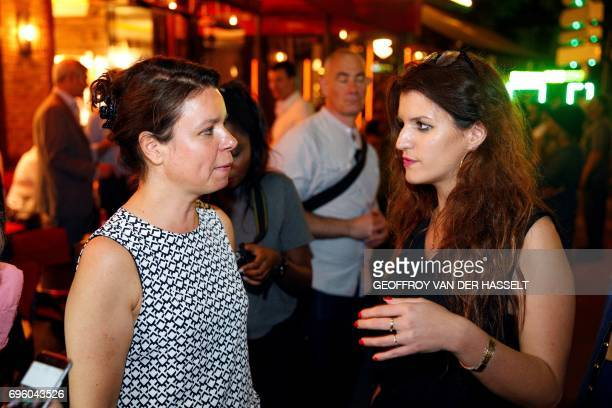French 'La Republique En Marche' party candidate in the 14th constituency of Paris Valerie BougaultDelage speaks with French Minister of State for...