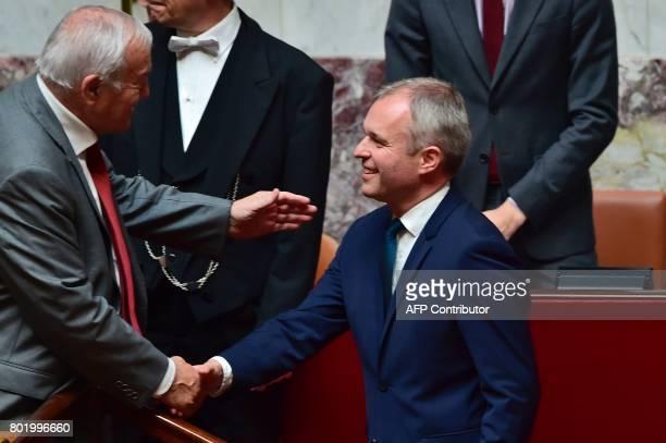 French La Republique en Marche party's Member of Parliament Francois de Rugy is congratulated by French Les Republicains party lawmaker Bernard...