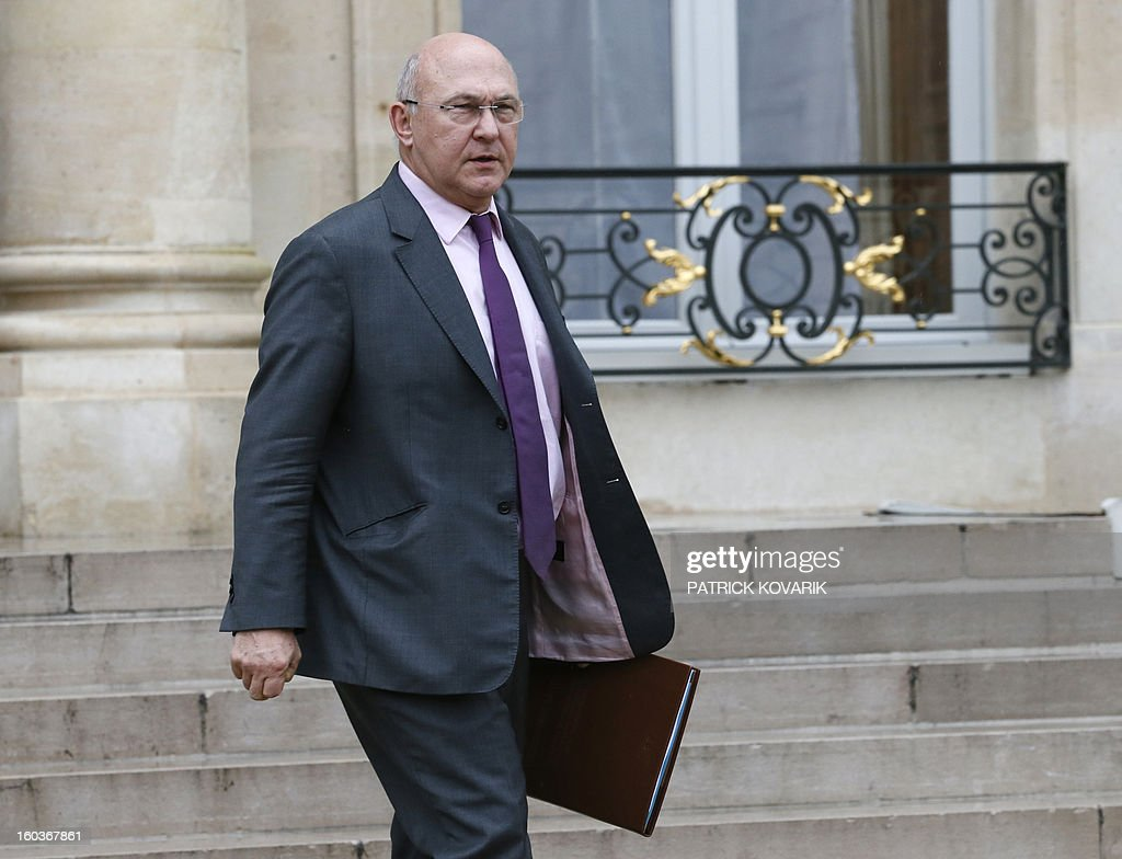French Labour, Employment and Social Dialogue, Michel Sapin, leaves the Elysee Presidential Palace after the weekly cabinet meeting on January 30, 2013 in Paris.