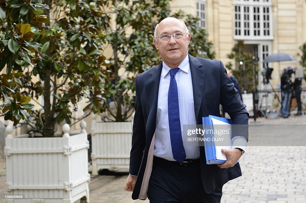 French Labour, Employment and Social Dialogue Minister, Michel Sapin arrives to take part in a government seminar focusing on the government's agenda for the coming year on January 4, 2013 at the Hotel Matignon in Paris.