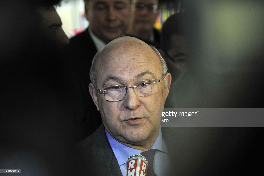 French Labour, Employment and Social Dialogue minister Michel Sapin speaks to journalists in a French state employment agency, Pole Emploi, in Nantes, western France on February 13, 2013 following the self immolation of an unemployed Frenchman outside the agency. The man had sent messages to journalists warning he would set himself alight this week after being declared ineligible for unemployment benefits. The number of unemployed has risen steadily in France for the past 20 months, and could soon reach the record high set in January 1997 of 3.2 million. AFP PHOTO / ALAIN LEMASSON
