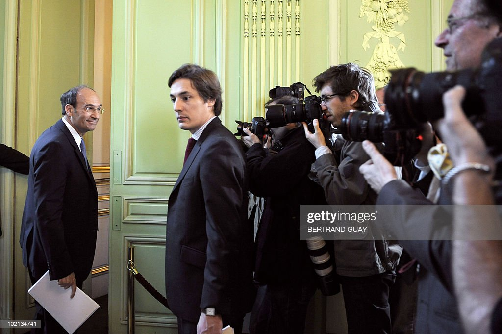 French Labour Minister Eric Woerth (L) leaves a press conference on the pension system on June 16, 2010 at the ministry in Paris. The French government unveiled a sweeping overhaul of its pensions system, raising the retirement age to 62 as it seeks to plug a hole in its finances and avoid a clash with unions.