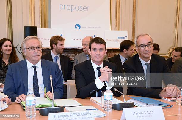French Labour Minister Francois Rebsamen Prime Minister Manuel Valls and CommissionerGeneral of the French General Commission for Strategy and...