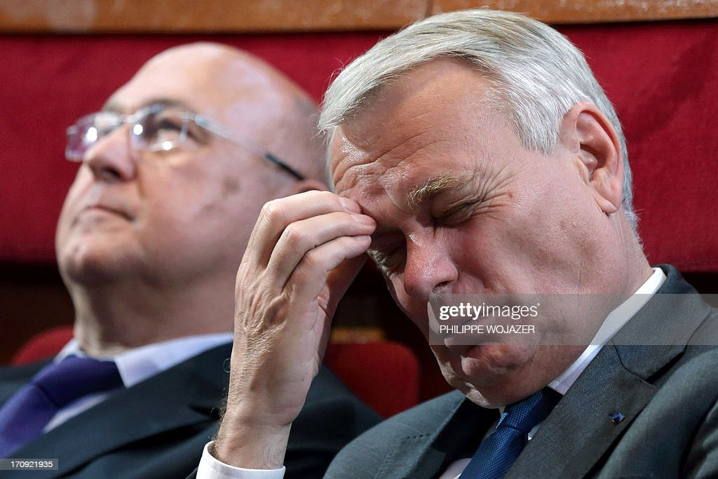 French Labour minister Michel Sapin (L) and Prime Minister Jean-Marc Ayrault attend the Social Conference, a 2-day conference to discuss economic reform plans with unions and workers in Paris on June 20, 2013.