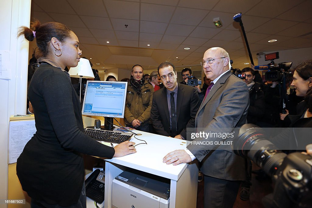French Labour Minister Michel Sapin (R) visits a Pole Emploi state employment agency on February 14, 2013 in Paris. The number of unemployed has risen steadily in France for the past 20 months, and could soon reach the record high set in January 1997 of 3.2 million.