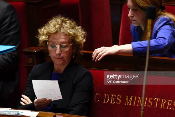 French Labour Minister Muriel Penicaud reads a note during a session at the French National Assembly on a bill allowing the government to change some...
