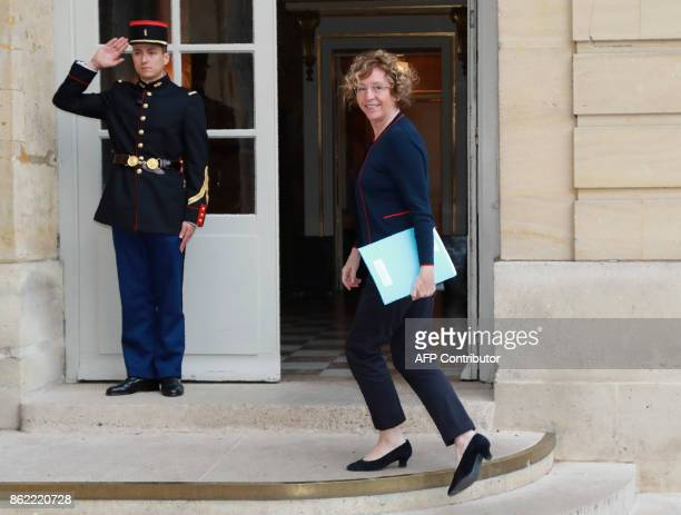 French Labour Minister Muriel Pénicaud receives a salute as she arrives at Hotel de Matignon in Paris on October 17 for talks between union leaders...