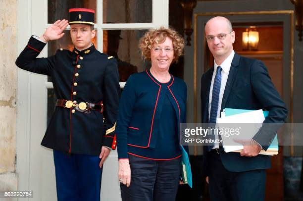 French Labour Minister Muriel Pénicaud receives a salute with French Education Minister JeanMichel Blanquer as they arrive at Hotel de Matignon in...