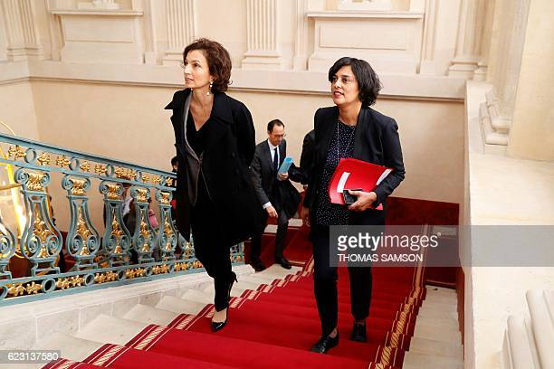 French Labour Minister Myriam El Khomri and French Culture Minister Audrey Azoulay climb stairs at the Labour Ministry in Paris prior to a meeting...