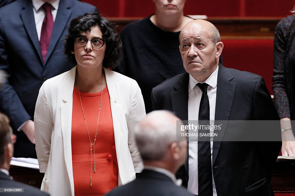 French Labour minister Myriam El Khomri and French Defence minister Jean-Yves Le Drian observe a minute of silence for the victims of the attacks at Istanbul's Ataturk airport during the questions to the government session on June 29, 2016 at the French National Asssembly in Paris. / AFP / Thomas SAMSON