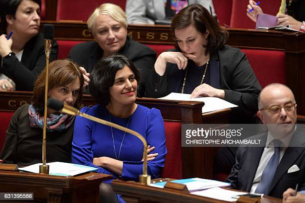 French Labour Minister Myriam El Khomri listens to French Minister for Family Children and Women's Rights Laurence Rossignol as they attend a session...