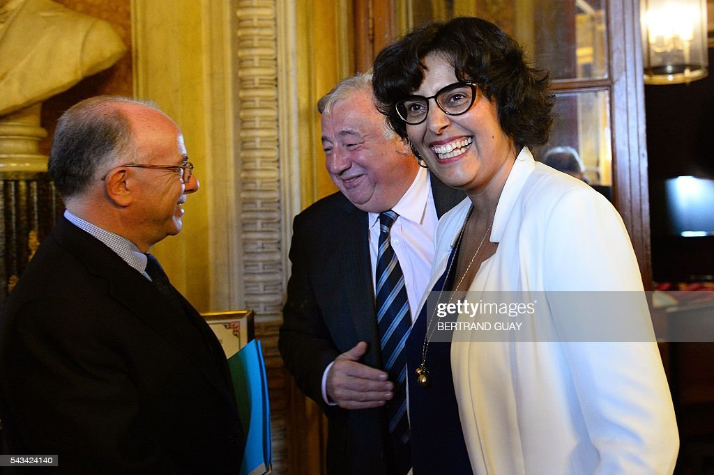 French Labour Minister Myriam El Khomri (R) reacts as she speaks with French Interior minister Bernard Cazeneuve (L) and French Senate President Gerard Larcher (C) after a debate concerning the labour reform at the French Senate in Paris on June 28, 2016. / AFP / BERTRAND