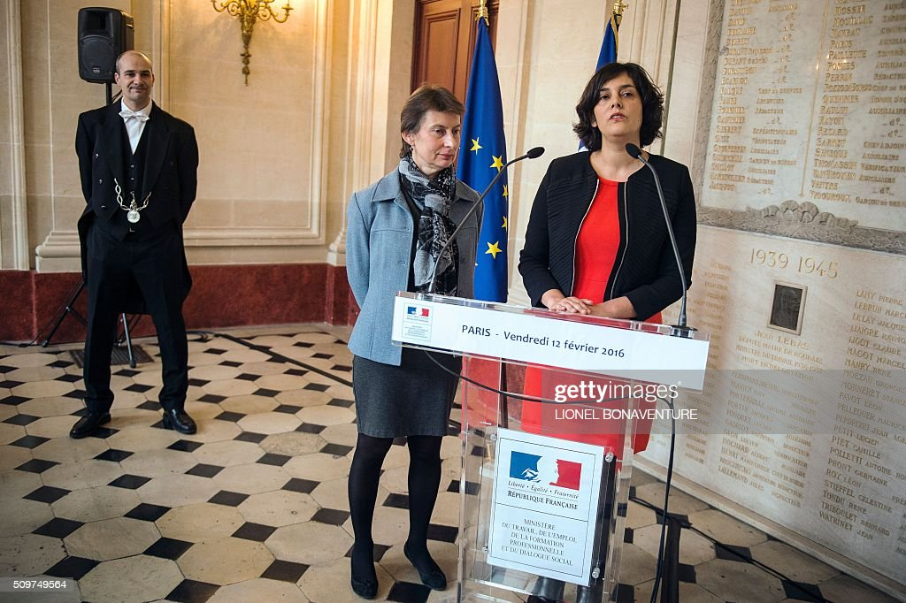 French Labour minister Myriam El Khomri (R) speaks as newly appointed Minister of State for Vocational Training, Clotilde Valter listens during a ceremony at the Labour ministry in Paris on February 12, 2016. / AFP / LIONEL BONAVENTURE