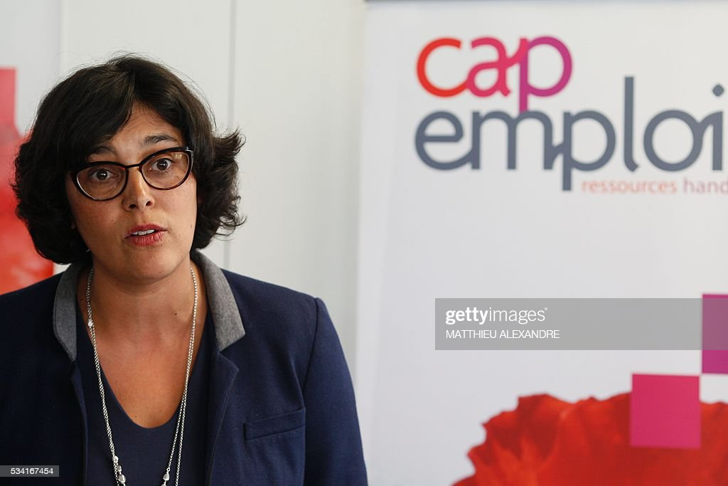 French Labour minister Myriam El-Khomri addresses journalists as she visits Cap Emploi, France's national employment agency for disabled people, on May 25, 2016 in Paris. / AFP / MATTHIEU