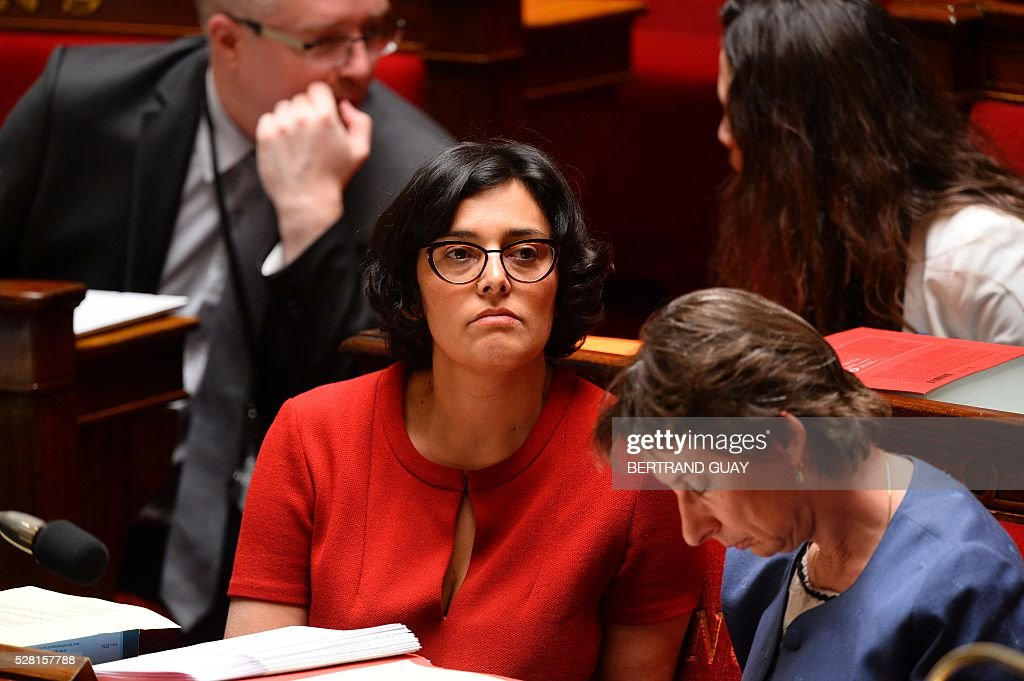 French Labour minister Myriam El-Khomri (C) attends a debate on the controversial labour reform bill at the French National Assembly in Paris, on May 4, 2016. French government says the bill is designed to unlock France's rigid labour market and cut stubbornly high unemployment of around 10 percent -- the issue that has dogged Socialist President Francois Hollande's four years in power.