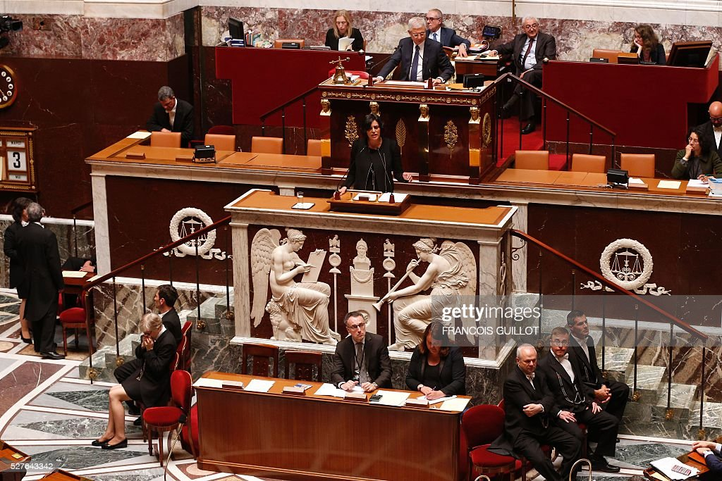 French Labour minister Myriam El-Khomri (C) delivers a speech during a session of Questions to the government, on May 3, 2016 at the French National assembly in Paris.