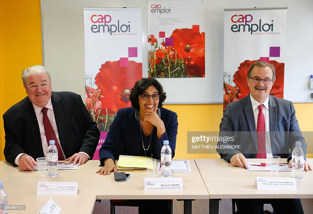 French Labour minister Myriam El-Khomri (C), Ile-de-France Prefect Jean-Francois Carenco (R) and Member of Parliament Daniel Vaillant (L), give a press conference during a visit to Cap Emploi, France's national employment agency for disabled people, on May 25, 2016 in Paris. / AFP / MATTHIEU
