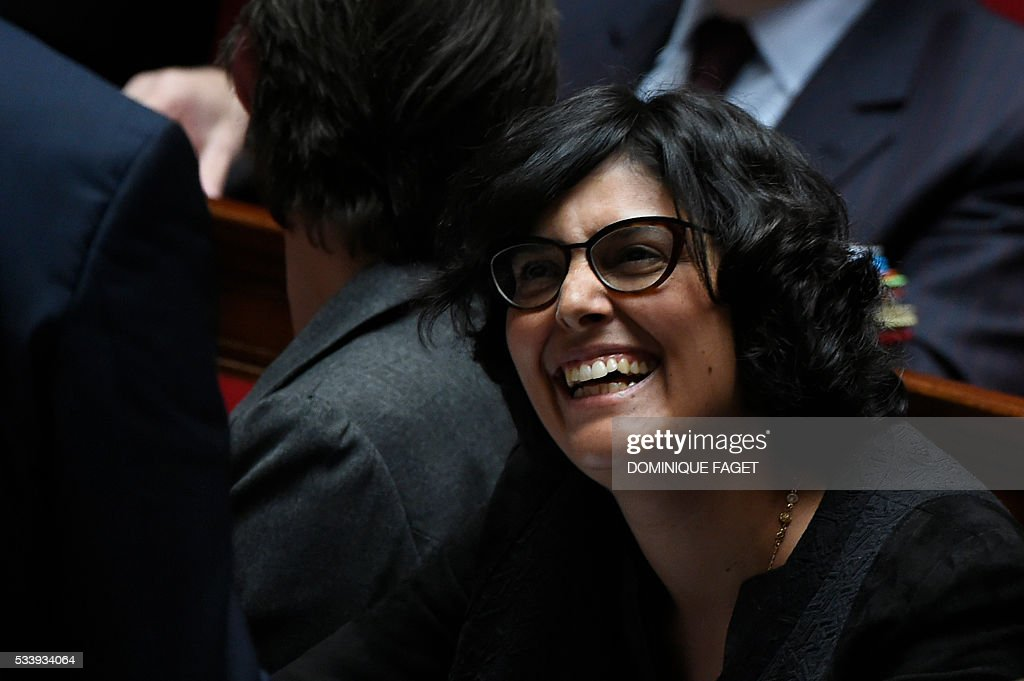 French Labour minister Myriam El-Khomri laughs during a session of Questions to the Government, on May 24, 2016 at the National Assembly in Paris.