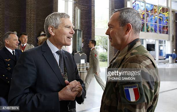 French land chief of staff General JeanPierre Bosser speaks with the president of the Polytechnic School Jacques Biot on May 28 2015 as he arrives to...