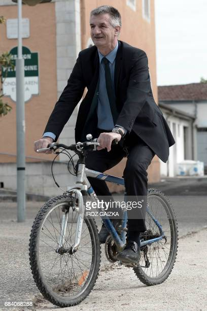French lawmaker and former independent candidate for the presidential election Jean Lassalle arrives by bike for a press conference to announce his...