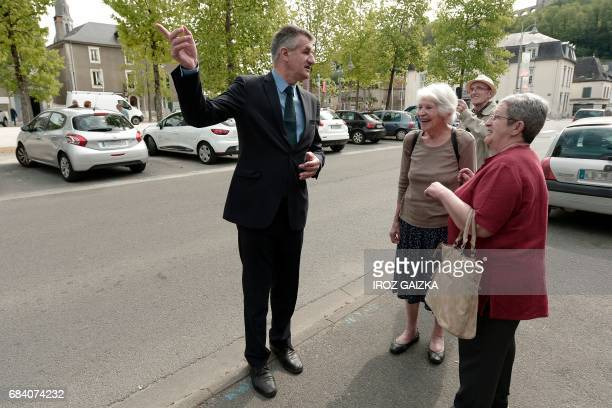 French lawmaker and former independent candidate for the presidential election Jean Lassalle speaks with people as he arrives for a press conference...