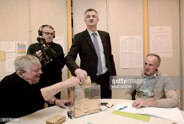 French lawmaker and independent candidate for French presidential election Jean Lassalle casts his ballot in LourdiosIchere southwestern France on...
