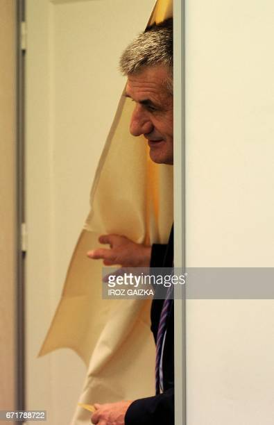 French lawmaker and independent candidate for French presidential election Jean Lassalle leaves the polling booth as he prepares to cast his ballot...