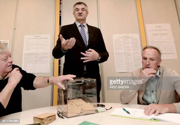 French lawmaker and independent candidate for French presidential election Jean Lassalle gestures as he prepares to cast his ballot in LourdiosIchere...