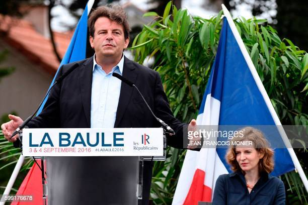 French lawmaker and rightwing 'Les Republicains' party member Thierry Solere delivers a speech flanked by French member of Parliament and candidate...