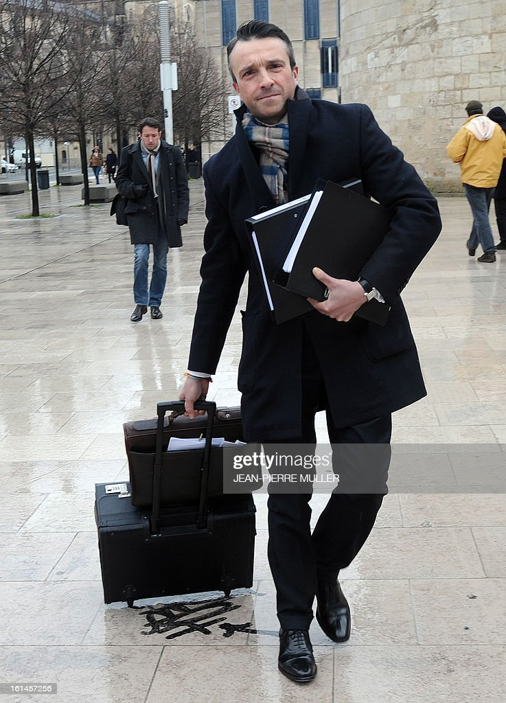 French lawyer Christophe Ingrain, a former Justice advisor of former president Nicolas Sarkozy, arrives on February 11, 2013 at Bordeaux's courthouse, for an hearing of his client French businessman Stephane Courbit as part of the Bettencourt case.
