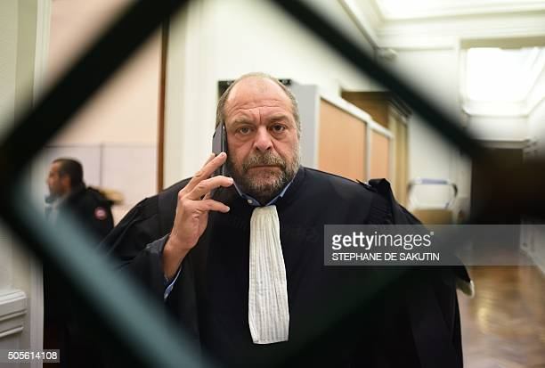 French lawyer Eric DupondMoretti lawyer for the nanny's partner Chinese national Te Lu speaks on his mobile phone on January 19 2016 at the Paris...