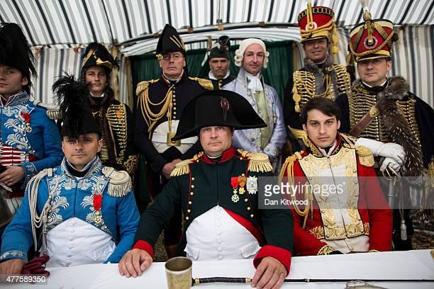 French lawyer Franck Samson dressed as Napoleon Bonaparte poses inside his tent on June 18 2015 in Waterloo Belgium Around 5000 historical reenactors...