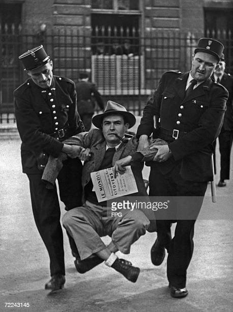 French lawyer Henri Marcais is forcibly removed from outside the Palais Bourbon seat of the French National Assembly in Paris 31st May 1950 Mr...
