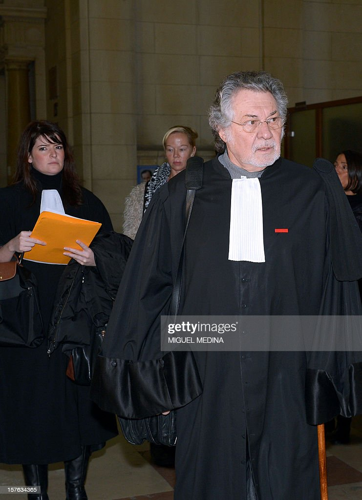 French lawyer Jean-Louis Pelletier (R) enters the courtroom at the Paris courthouse on December 5, 2012 before the trial of 10 suspects charged with extorting funds and associating with mobsters in relation with the January 2011 takeover of the Wagram circle gambling establishment in Paris by people related to alleged gansgsters from the Mediterranean island of Corsica.