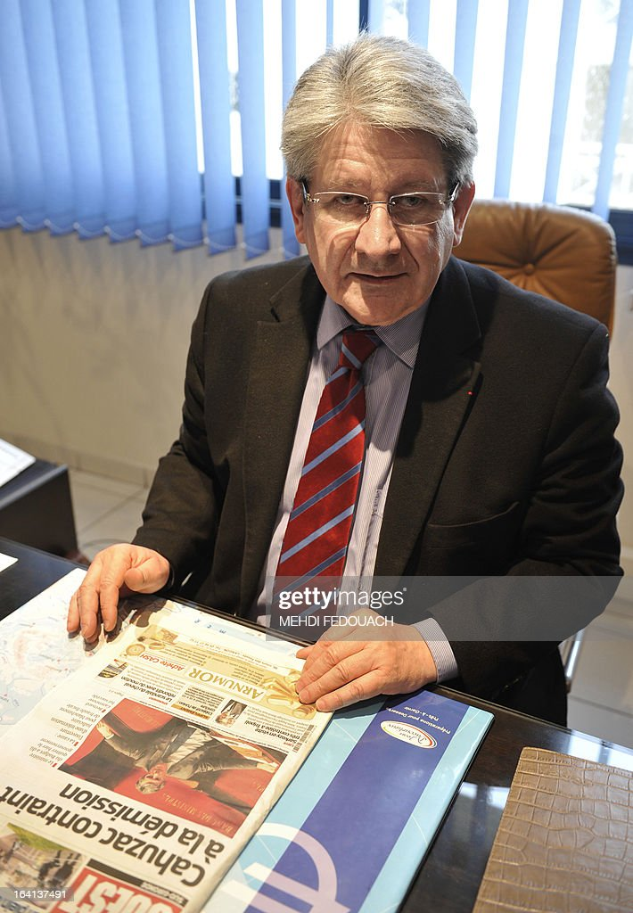 French lawyer Michel Gonelle, the holder of a recording on which, according to French justice, French Budget Minister Jerome Cahuzac probably confesses he 'had for many years held an undeclared bank account' with Swiss banking giant UBS in Geneva, poses on March 20, 2013 at his office in Villeneuve-sur-Lot, southwestern France. Gonelle, a long time political rival of Cahuzac and influential personality in the Lot et Garonne region, has ascended local politcal lader since 1977 and not without making enemies. Cahuzac resigned yesterday after prosecutors announced a probe into a Swiss bank account he allegedly used to hide assets from the tax authorities.
