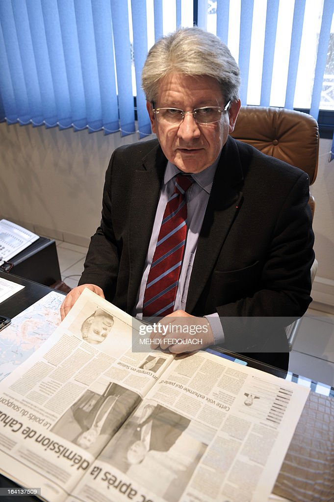 French lawyer Michel Gonelle, the holder of a recording on which, according to French justice, French Budget Minister Jerome Cahuzac probably confesses he 'had for many years held an undeclared bank account' with Swiss banking giant UBS in Geneva, poses on March 20, 2013 at his office in Villeneuve-sur-Lot, southwestern France. Gonelle, a long time political rival of Cahuzac and influential personality in the Lot et Garonne region, has ascended local politcal lader since 1977 and not without making enemies. Cahuzac resigned yesterday after prosecutors announced a probe into a Swiss bank account he allegedly used to hide assets from the tax authorities. AFP PHOTO / MEHDI FEDOUACH