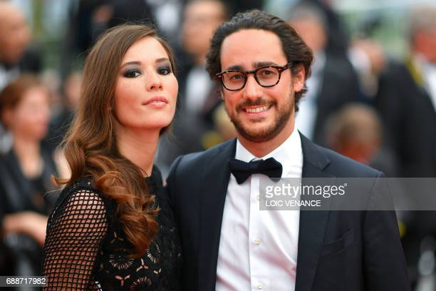 French lawyer Thomas Hollande and his partner journalist Emilie Broussouloux pose as they arrive on May 26 2017 for the screening of the film...