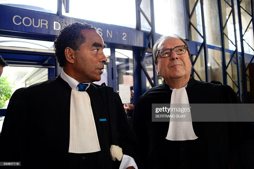 French lawyers Alex Ursulet (L) and Christian Charriere-Bournazel stand at the court of Bobigny, northern Paris on May 27, 2016 during the trial of 15 French CGT union's members judged for the episode of the torn shirt, in full showdown initiated by the union with the government on labor law. the court of Bobigny, northern Paris on May 27, 2016 during the trial of French CGT union's members judged for the episode of the torn shirt, in full showdown initiated by the union with the government on labor law. On October 5, 2015 under the cries of naked, naked and resignation , the Air France human resources director found himself shirtless, tattered shirt during a protest after the announcement of a restructuring of the airline threatening nearly 3,000 jobs.