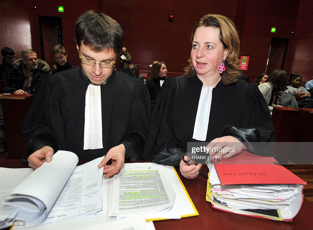 French lawyers Cecile de Oliveira (R) and Loic Bourgeois stand in the courthouse of Nantes, western France, on March 28, 2013, where they represented Lies Hebbadj, a businessman from Nantes who was made famous in 2010 when he was accused by then interior minister Brice Hortefeux of being a polygamist. Hebbadj was sentenced today to a suspended sentence of six months in prison for business which he did not declare to the authorities. AFP PHOTO / FRANK PERRY
