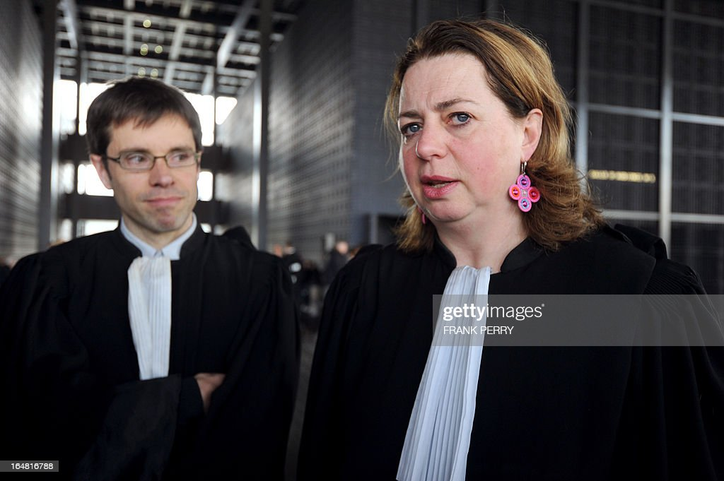 French lawyers Cecile de Oliveira (R) and Loic Bourgeois stand in the courthouse of Nantes, western France, on March 28, 2013, where they represented Lies Hebbadj, a businessman from Nantes who was made famous in 2010 when he was accused by then interior minister Brice Hortefeux of being a polygamist. Hebbadj was sentenced today to a suspended sentence of six months in prison for business which he did not declare to the authorities.