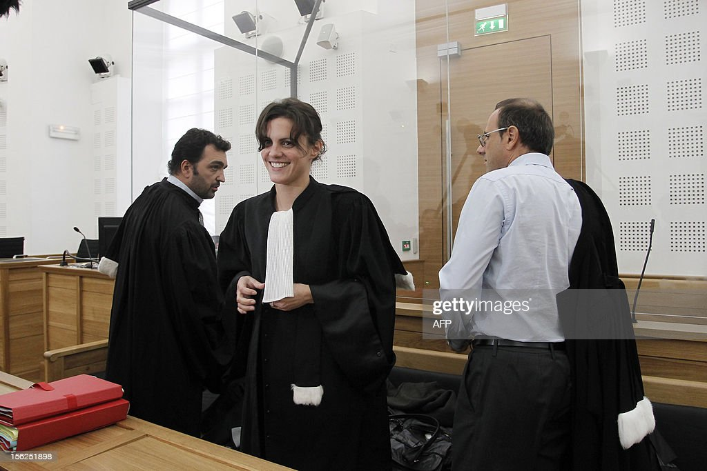 French lawyers of a 19-year-old boy Jean-Charles Vincensini, Romina Cresci and Marc Maroselli, wait for the start of his trial for shooting dead his parents and 10-year-old twin brothers in 2009, on November 12, 2012 in a courtroom in Ajaccio. The accused, named as Andy, exterminated the entire family in August 2009 with his father's Winchester rifle in an act he said occurred in a trance-like state.