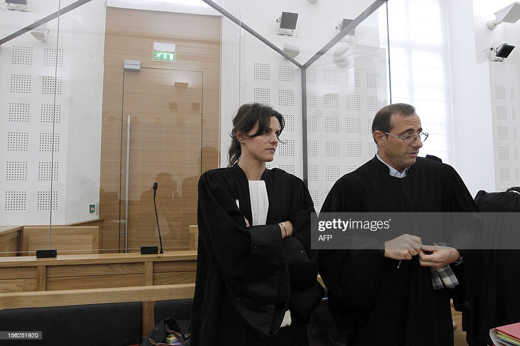 French lawyers of a 19-year-old boy Romina Cresci (L) and Marc Maroselli, wait for the start of his trial for shooting dead his parents and 10-year-old twin brothers in 2009, on November 12, 2012 in a courtroom in Ajaccio. The accused, named as Andy, exterminated the entire family in August 2009 with his father's Winchester rifle in an act he said occurred in a trance-like state.
