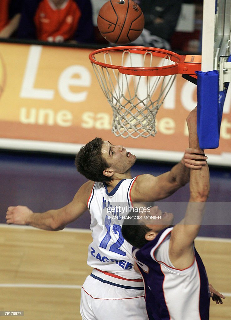 French Le Mans?s guard Antoine Diot (R) fights for the ball with Croatian Cibona Zagreb?s center Luksa Andric (L) during their Euroleague Basketball match in Le Mans, 23 January 2008.
