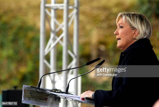 French leader of the farright Front National party Marine Le Pen delivers a backtowork speech on September 9 2017 in Brachay eastern France / AFP...