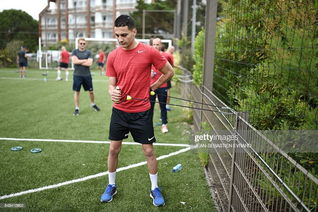 French League 1 football referee Karim Abed takes part in a training camp in Quiberon, western France, on June 28, 2016, ahead of the 2016/2017 French L1 football season. The French Ligue 1 football season will start on August 12, 2016. / AFP / JEAN