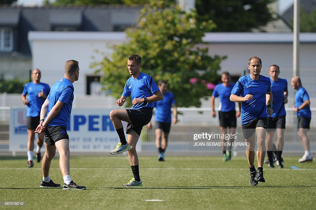 French League 1 football referees take part in a training session during their internship in Quiberon, western France, on June 25, 2014, ahead of the 2014/2015 French L1 football season that will start on August 9, 2014.
