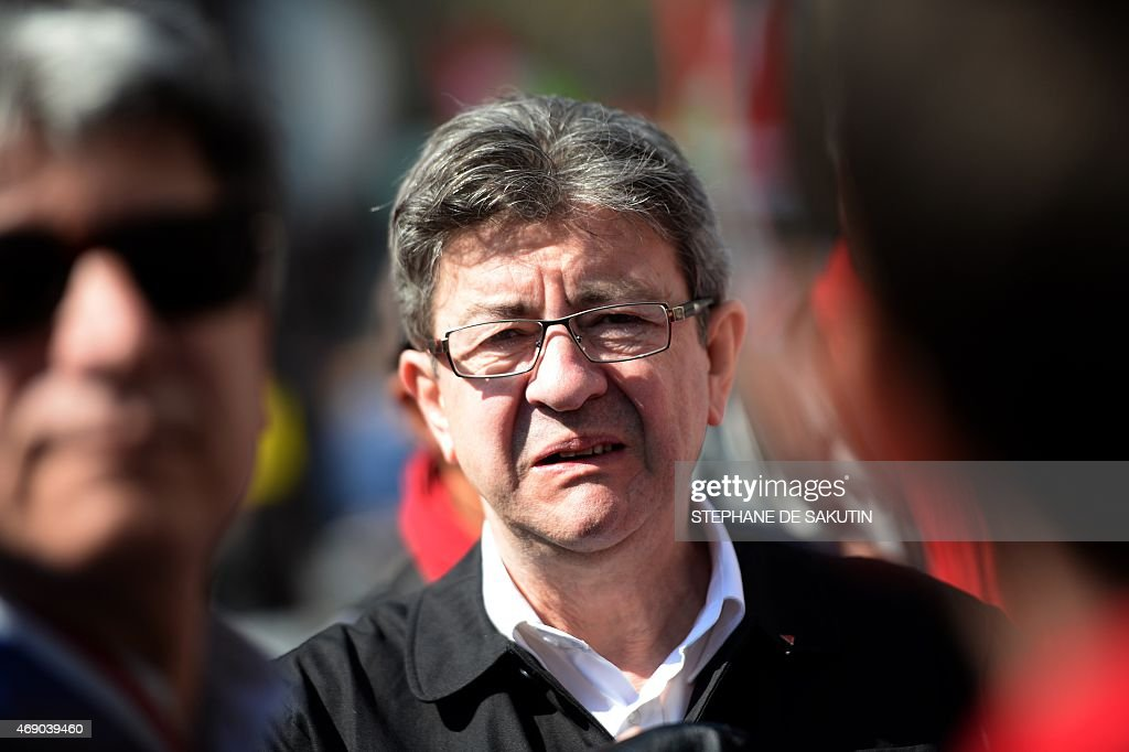 French Left Party (PG, Parti de Gauche) co-president Jean-Luc Melenchon takes part in a protest march as part of a national mobilization against the government's austerity measures and for alternatives reforms favoring better jobs and salaries, on April 9, 2015 in Paris.